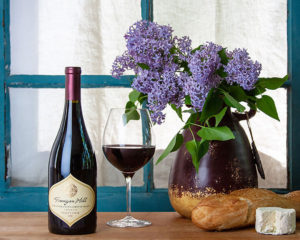 bottle of wine, bouquet of lilacs