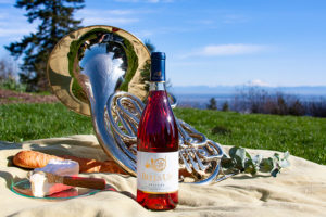 picnic scene with wine and French horn